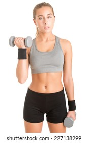 Woman working out with dumbbells, isolated in white