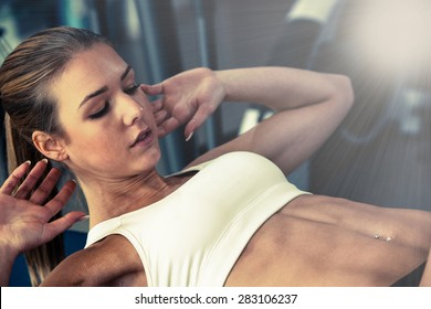 Woman working out in fitness - Active girl - focused beautiful athletic woman working ab intervals - professional fitness and bodybuilding competitor workout in health club gym exercise abs