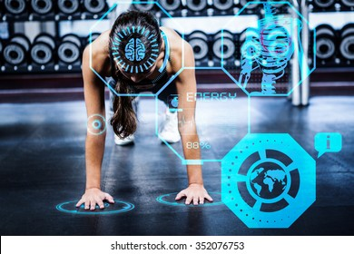 Woman working out in gym against fitness interface