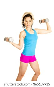 a woman working out her arms with weights with a smile.