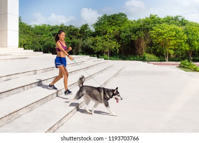 Woman working out with her dog