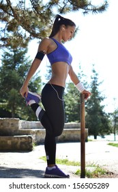 woman working out in the park