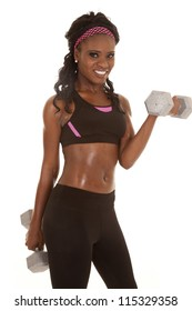 A woman working out with weights with a smile on her face.