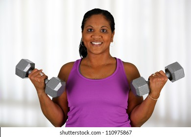 Woman working out while at a gym
