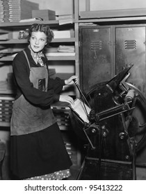Woman working in print shop