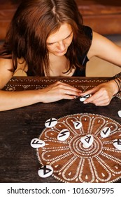 Woman working with runes