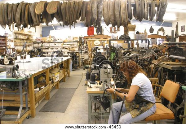 woman working at saddle shop