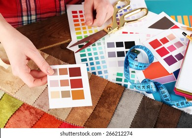 Woman working with scraps of colored tissue and palette close up