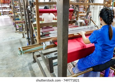 The woman working. Silk thread texture, traditional thai fabric, The process of silk weaving in the production. Industrial in northern Thailand.