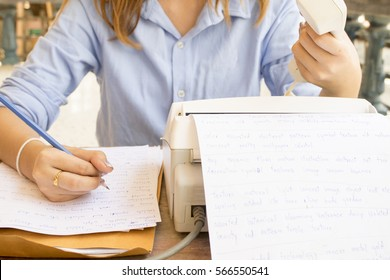 woman working transmitter fax document is office equipment
