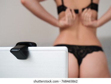 Woman working as webcam model. Removes the bra.