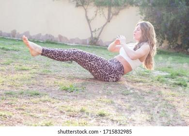 Woman workout abdomen exercise in garden