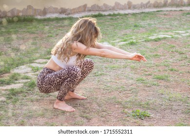 Woman workout in back yard on summer day