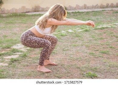 Woman workout exercising in garden on summer evening