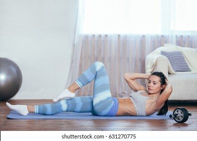 woman workout at home, her sit up