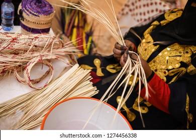 Woman works handicraft from Saudi Arabia.