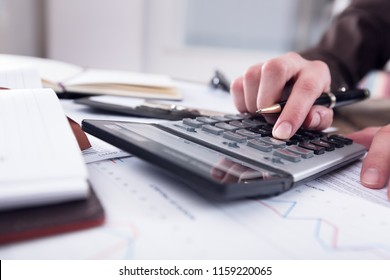 Woman works on a calculator