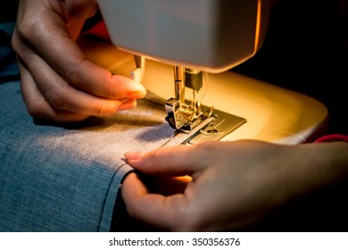 woman works at a sewing machine. Hands closeup/