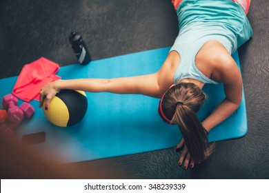 Woman worming up and stretching her body at the gym.Pilates.