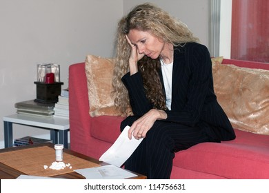 woman worried about bills and debt and foreclosure and thinking about taking pills