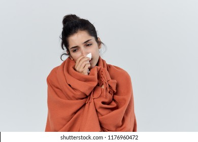 woman wrapped in an orange plaid handkerchief in her hand