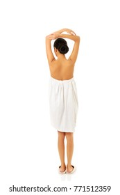 Woman wrapped in towel with crossed arms