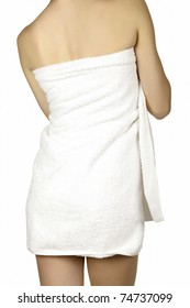 Woman wrapped in a towel posing on white background