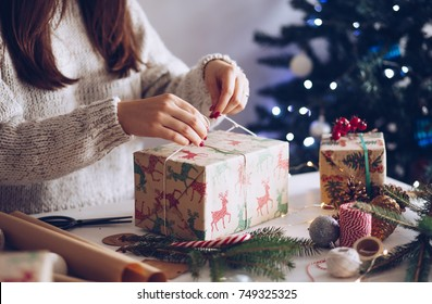 Woman wrapping gifts for Christmas