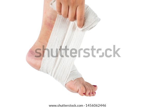 Woman Wrapping Her Leg Sprained Ankle Stock Photo Edit Now