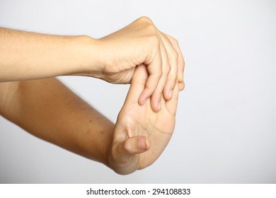 Woman with wrist complaints on white background