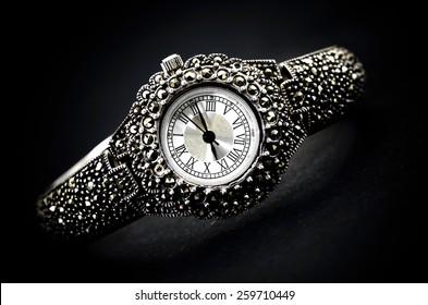 woman wristwatch on black background