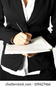 Woman write on document