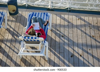 A woman writes aboard a cruise ship