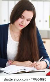 Woman writes with enthusiasm
