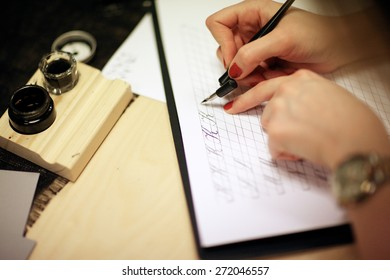 Woman writing calligraphic letters