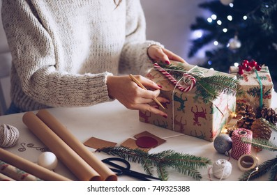 Woman writing Christmas note