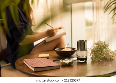 Woman writing down her ideas