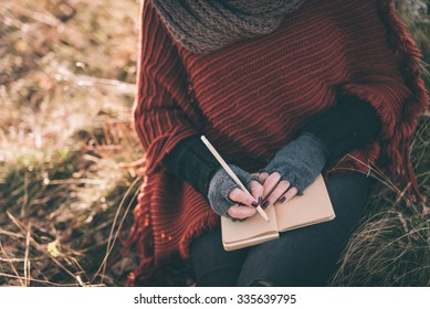 Woman writing in the notebook