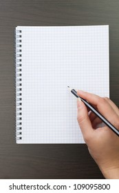 woman writing on notebook in the office