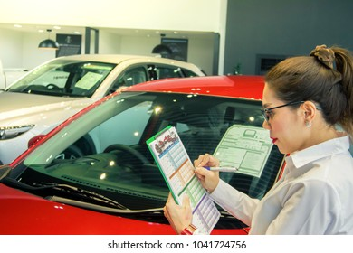Woman writing on notepad or book, paper with car and blurry background. for note, transport, business, copy space image.