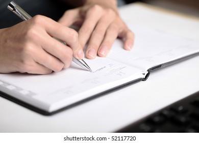 "Woman writing ""to do list"""