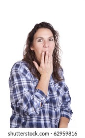 A woman is yawning with her hand on her mouth.