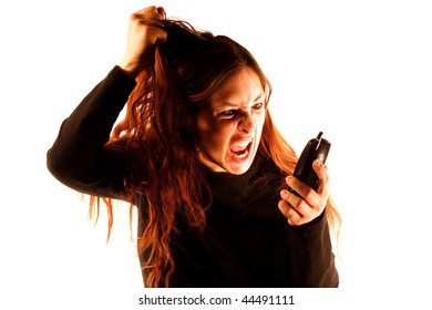 A woman yelling into a phone in front of a white background.