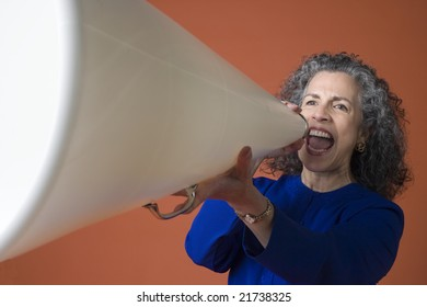 Woman yelling with a megaphone on an orange background