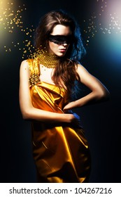 woman in yellow dress and black mask with broken jewelry