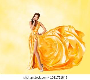 Woman Yellow Dress, Happy Fashion Model in Elegant Long Gown, Flying Artistic Waving Silk Tail