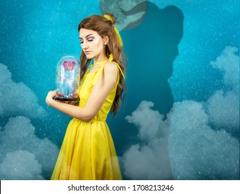 Woman in the yellow dress with red rose in her hands on the background of the beast . Beauty and the beast cosplay art processing. Beauty and the beast cosplay