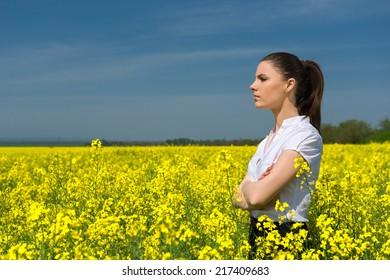 woman in yellow flower field