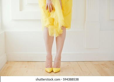 woman in yellow skirt and yellow shoes