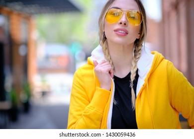 WOman in yellow sport jacket